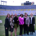 Sarita (pink jacket) at Lambeau field after speaking at Green Bay Mgmt Women event