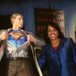 "Posing with ""Clark Kent"" after keynoting at superhero-themed event"