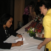 Sarita Maybin signing a book for a fan